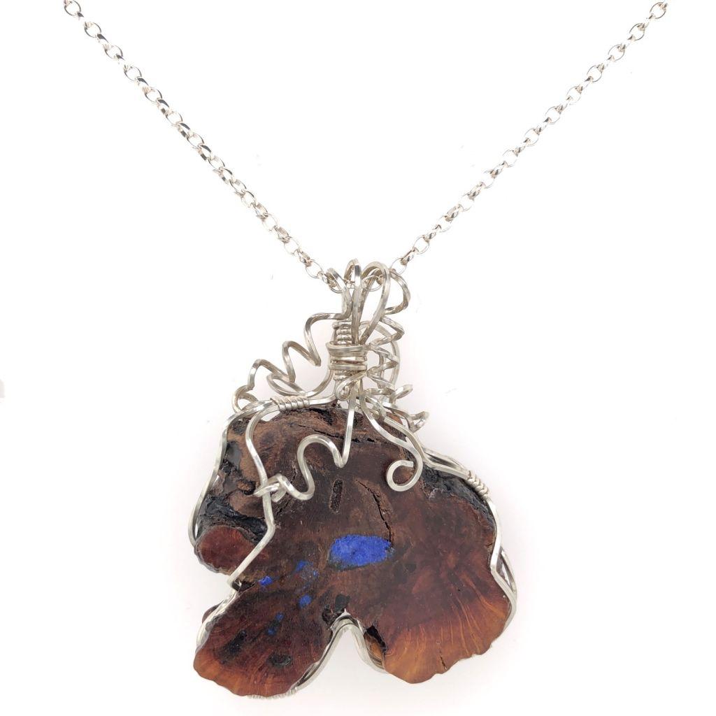 "Image Description of ""Sterling Silver Wire Wrapped Manzanita & Lapis Pendant Necklace""."