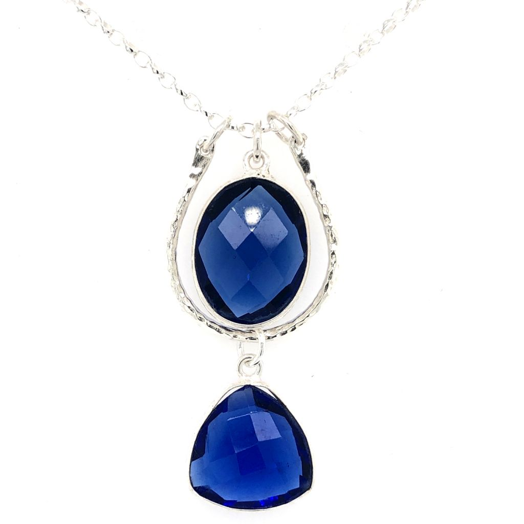 """Image Description of """"Sterling Silver Hammered Horseshoe-Shaped Link with Dark Blue Gemstones Necklace""""."""