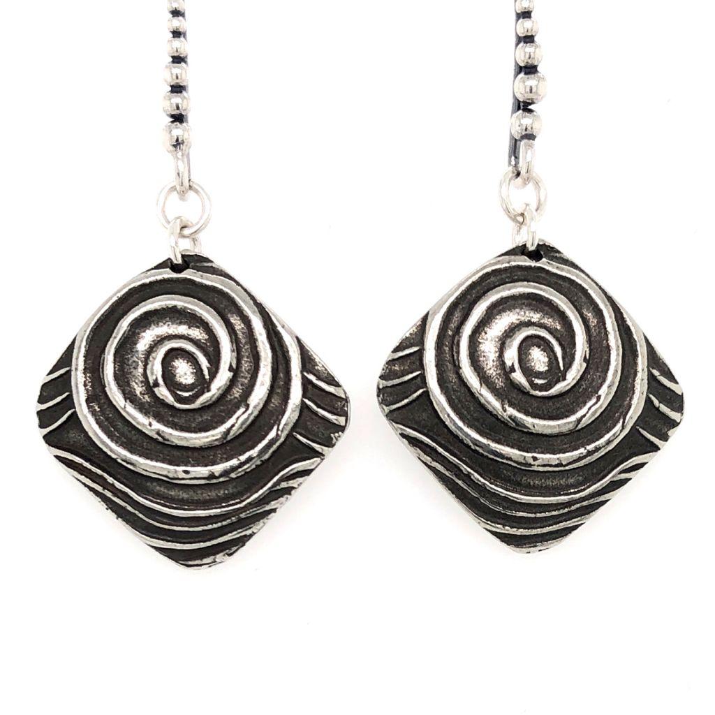 """Image Description of """"Dorabeth Drop Diamond Swirl Earrings""""."""