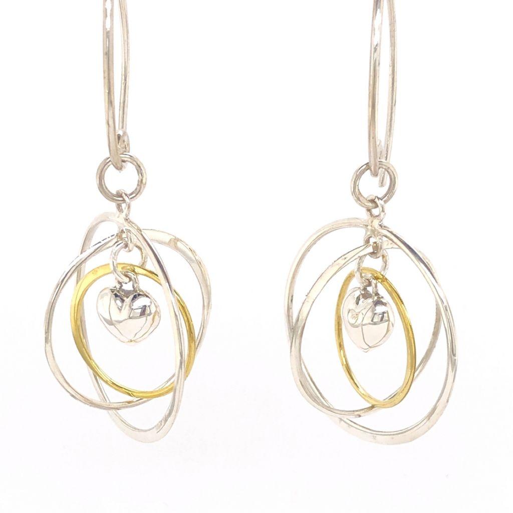 "Image Description of ""Sterling Silver & Gold Puffed Heart Gyroscope Earrings""."