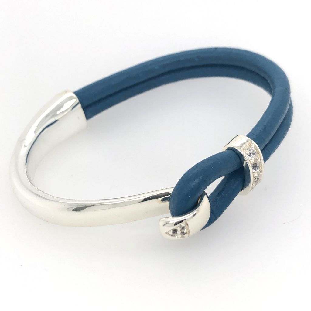"""Image Description of """"Cobalt Blue Round Portuguese Leather with Sterling Plated Bar Cuff Bracelet""""."""