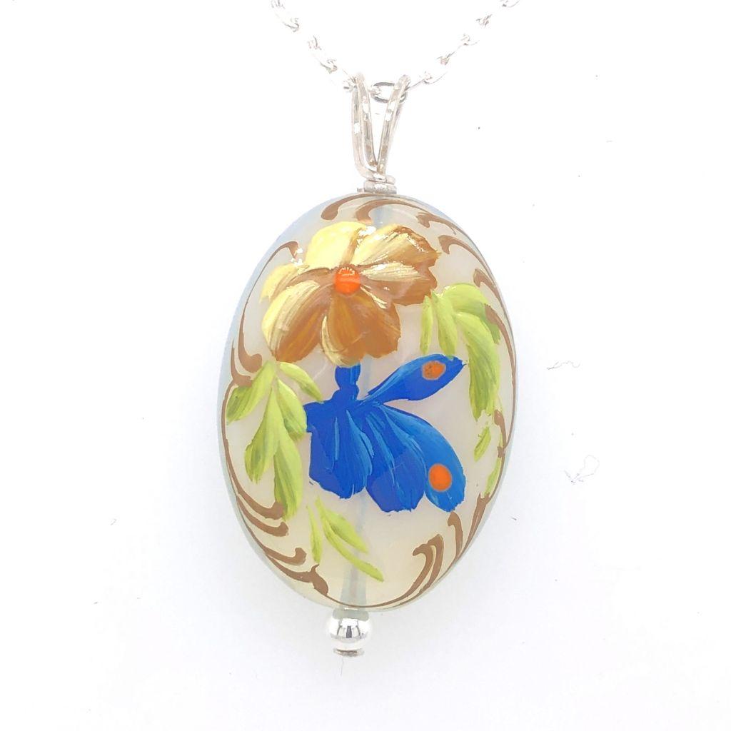 "Image Description of ""Oval Opal Glass Blue Butterfly Necklace""."