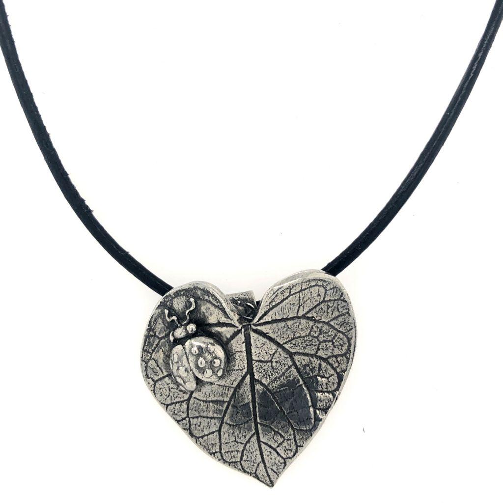 """Image Description of """"Dorabeth Designs Pewter Leaf with Ladybug on Leather Cord Necklace""""."""